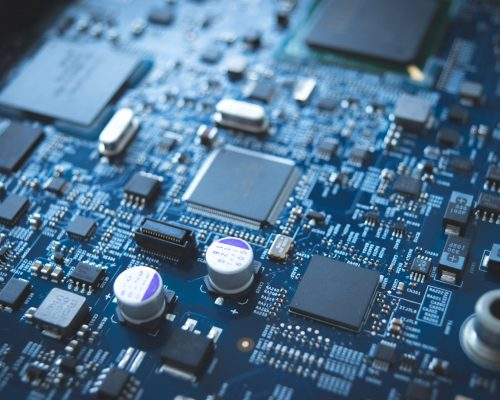 Computer board chip circuit cpu core blue technology background or texture with processors microelectronics hardware concept electronic device motherboard semiconductor